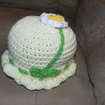 Infant Hat with Flower by Jeanne Stewart of Yarnjeannie's Crochet Cache