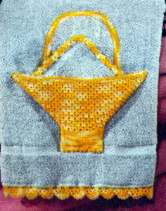 Applique Basket and Edgings Pattern by Free Vintage Crochet. The basket is shown appliqued into a towel.