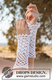 Myrtle by DROPS Design. These lacy  armwarmers are shown in white, making them perfect for weddings.