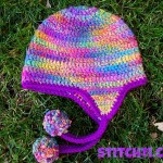 Curly Q – Earflap Hat by Stitch11