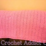 Lucky Candy Kisses Baby Cot Blanket by Crochet Addict