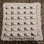 Cross-Over Long DC Dishcloth by Rhelena of CrochetN'Crafts