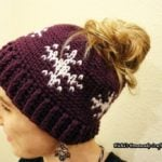 Snowflakes Messy Bun Hat by Nicole Riley of Nicki's Homemade Crafts
