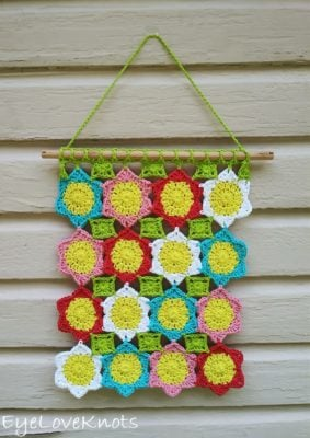 Lily's Floral Wall Hanging by Alexandra Richards/EyeLoveKnots