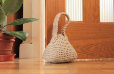 Crochet Pyramid Doorstop by Veronika Cromwell