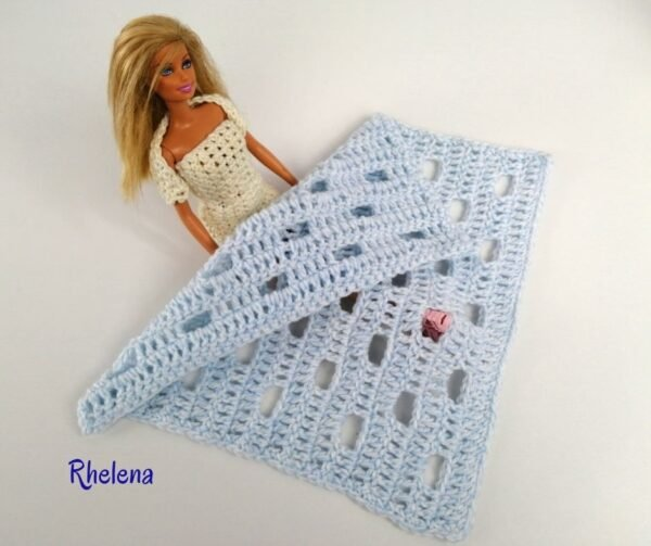 And open stitch crochet doll blanket shown with Barbie by CrochetnCrafts