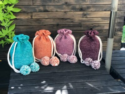 Crochet Pom Pom Drawstring Bag by KnitcroAddict