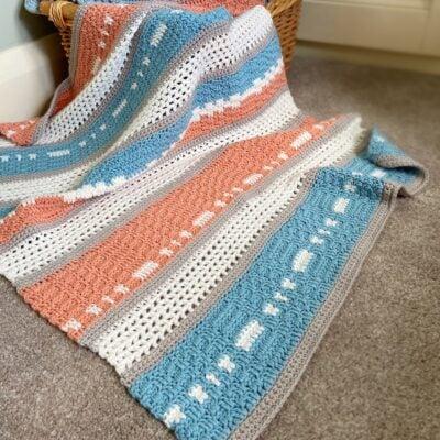 Peaches and Teal Modern Baby Blanket by Hannah Cross from HanJan Crochet