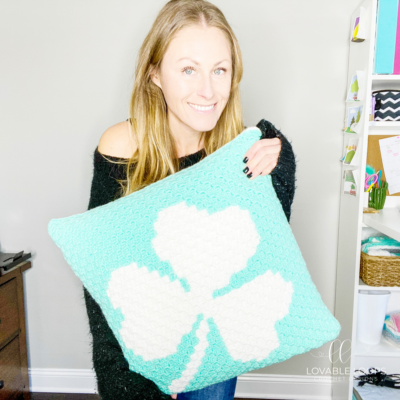 Shamrock Pillow by Melissa Hassler from Lovable Loops. This pillow features a large shamrock.