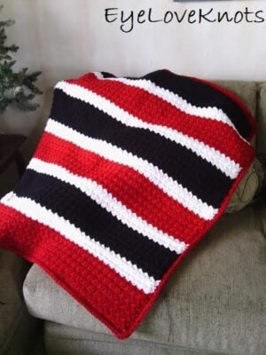 Suzette's Chunky Afghan shown in a striped design. Design by EyeLoveKnots.
