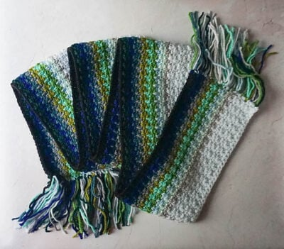 Ocean Fade Scarf by Marie Segares/Underground Crafter. The crochet scarf is shown beautiful stiped color design,