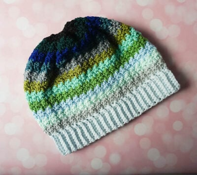 Ocean Fade Slouchy Hat by Marie/Underground Crafter. The hat is shown in stripes using white, gray, blue and green tones.