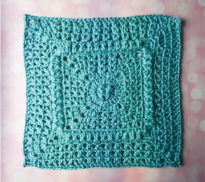 Popcorns and V-Stitch Square by Marie Segares/Underground Crafter. The square is worked up in a solid color yarn.