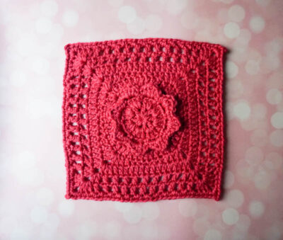 Serene Petals Square by Marie/Underground Crafter. This floral afghan square in shown in a bright pink.
