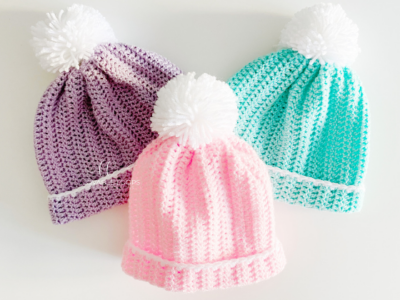 Easy Peasy Beanie by Melissa Hassler from Lovable Loops. The crochet hat is shown in three different colors and sizes.