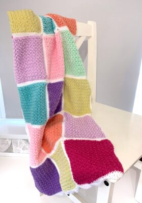Busy Lizzy's Patchwork Blanket by Rose Hudd from Memory Lane Crochet. The blanket is shown in cheerful spring colors.