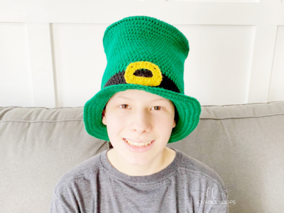 Leprechaun Top Hat by Melissa Hassler from Lovable Loops. The hat is modeled on a young teen.