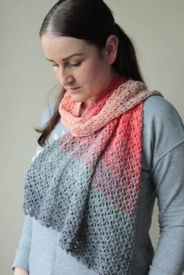 Painswick Shawl by Veronika Cromwell from Blue Star Crochet. The shawl is shown in pretty pinks and a gray tone.