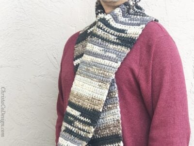 Pietra Scarf by Crystal from ChristaCoDesign. The scarf is shown in earth tones for men.