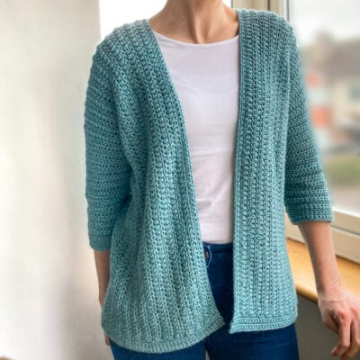 Spring Buds Cardigan by Sarah Ruane from Ned & Mimi. The cardigan is worn by a woman.